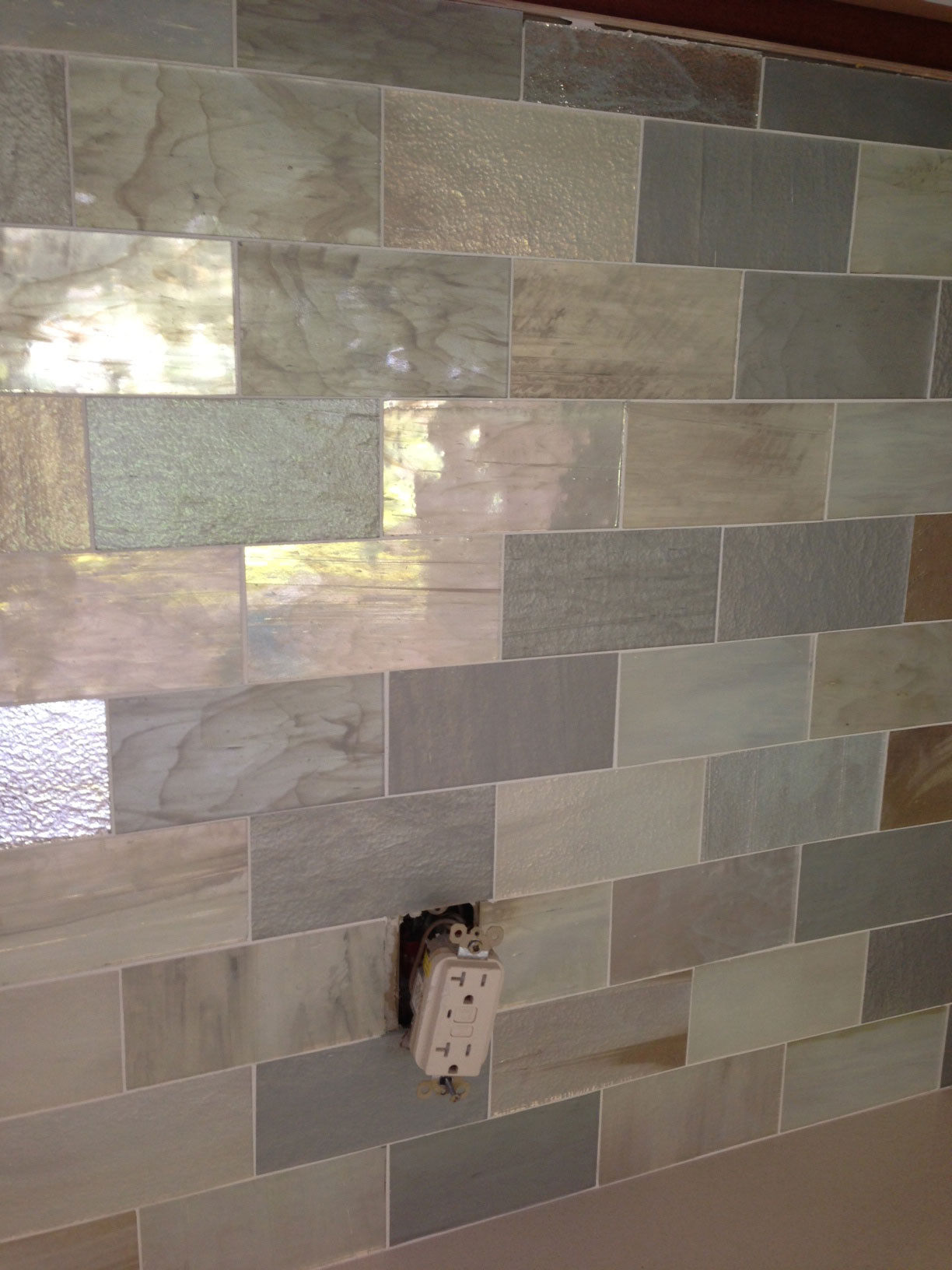 Lorna saunders interiors singer island house highlights handmade glass tile backsplash that resembles mother of pearl a nod to the homes sea side location caesarstone countertops dailygadgetfo Images